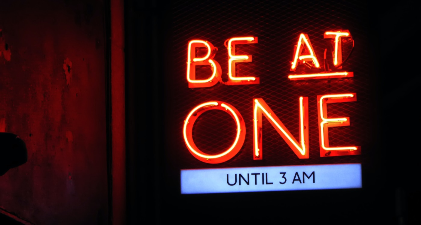 Neon sign: Be at one. Until 3am.