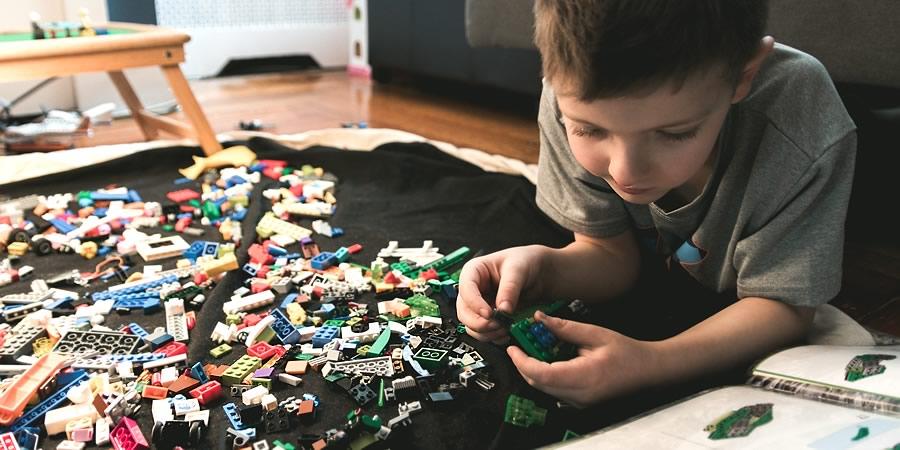 Child and lego.