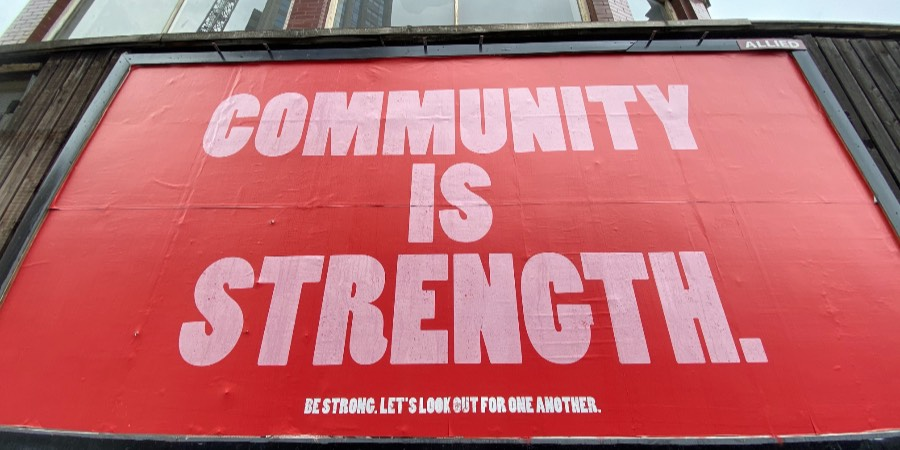 Street poster. Community is strength.