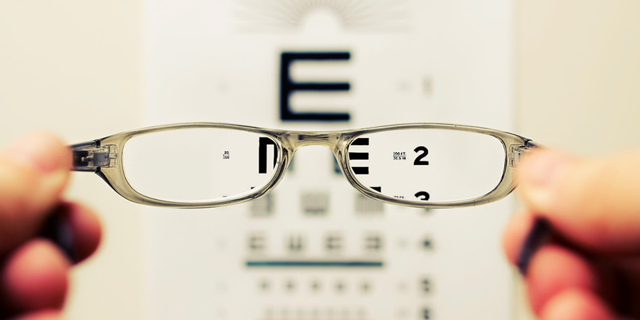 Snellen eye test chart and glasses.