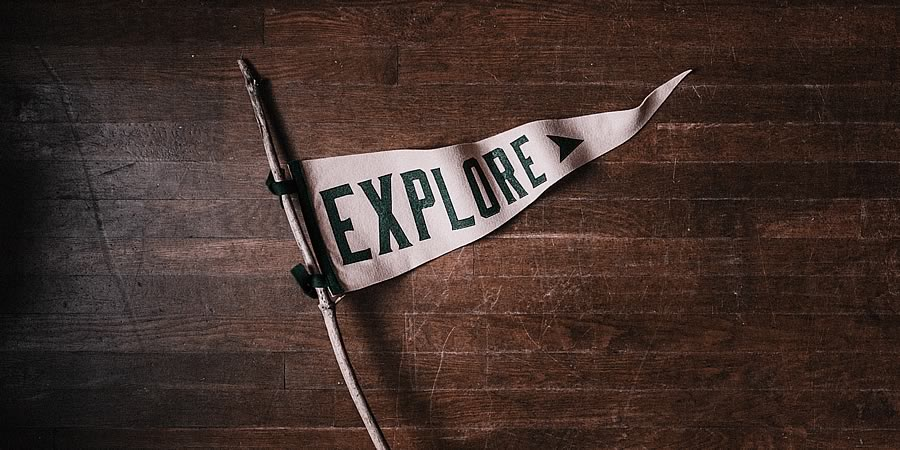 'Explore' on a pennant flag.