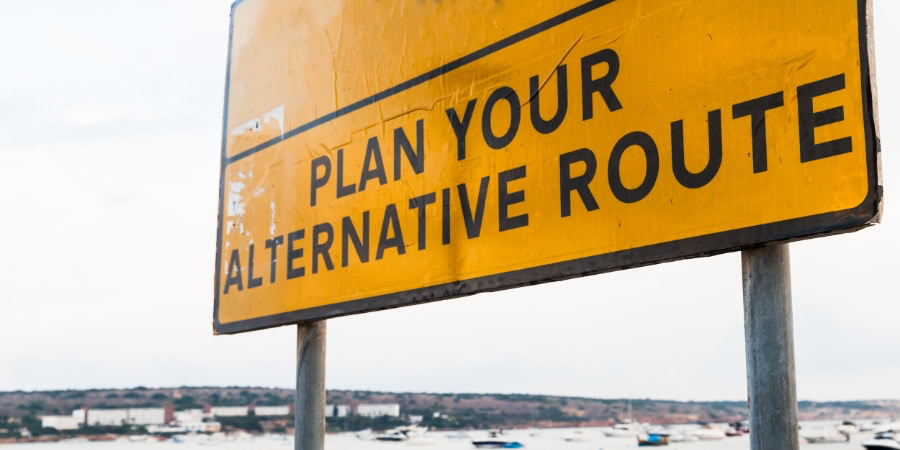 Road sign. Plan your alternative route.