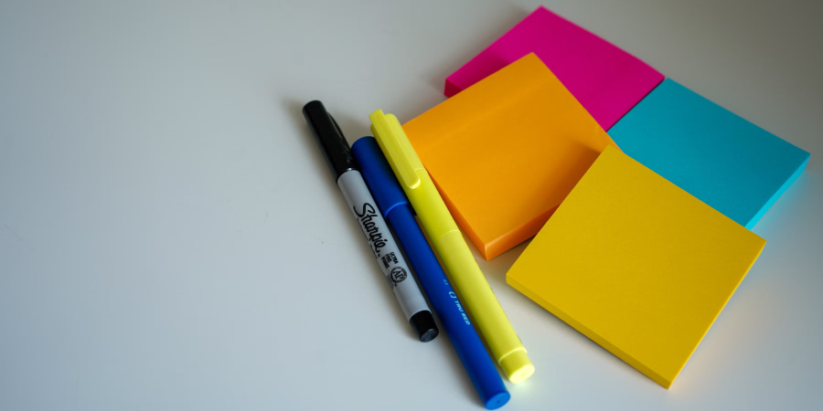 Sticky notes and pens.