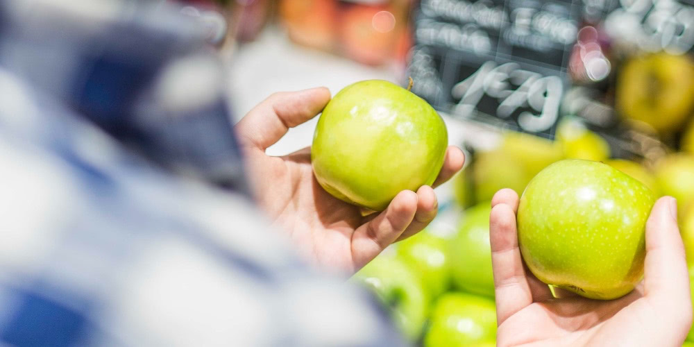 Comparing apples at the grocers.